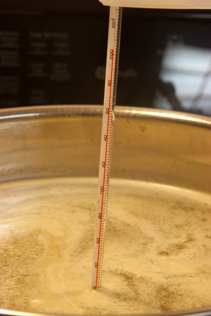 Waiting for the wort to boil after adding the malt extract syrup