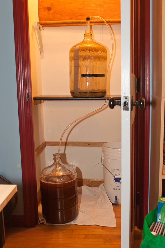Transferring to the secondary carboy after a week, leaving the sludge behind (great for the compost, bad for beer)